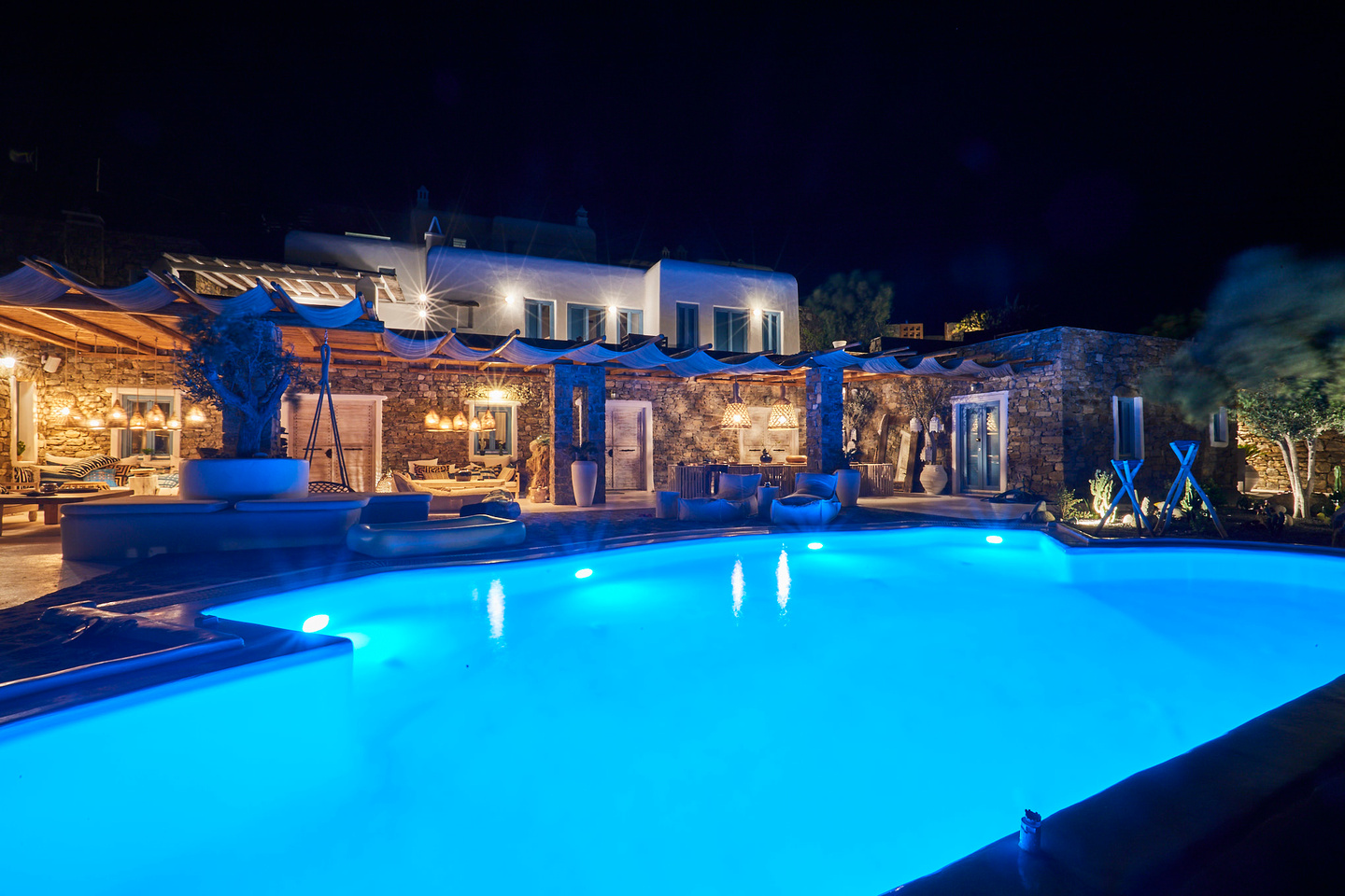 RENT A LUXURIOUS VILLA BY THE SEA IN MYKONOS - VILLA KARKOS - swimming pool at night
