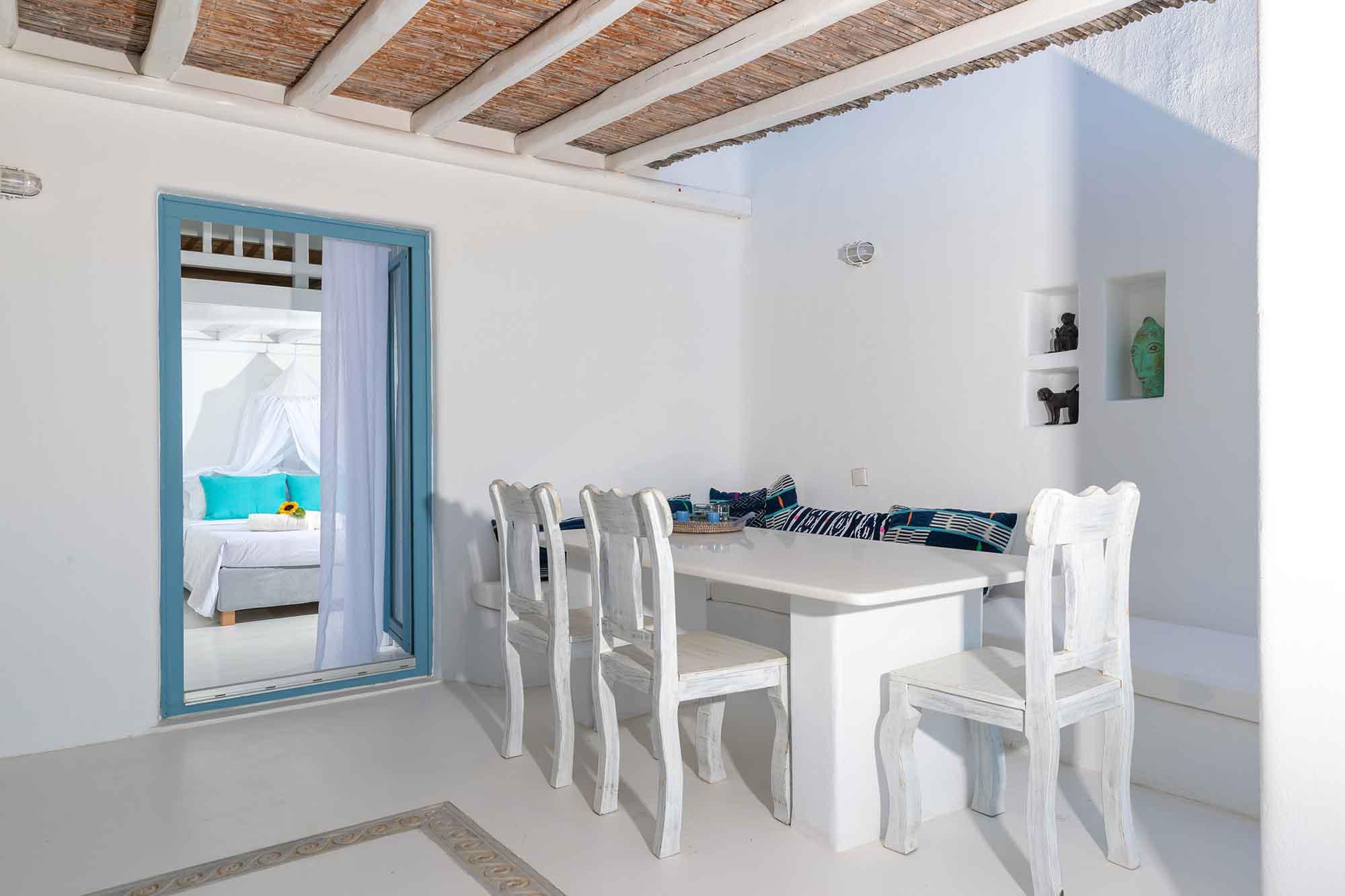 RENT A LUXURIOUS VILLA BY THE SEA IN MYKONOS - VILLA KARKOS - dining room