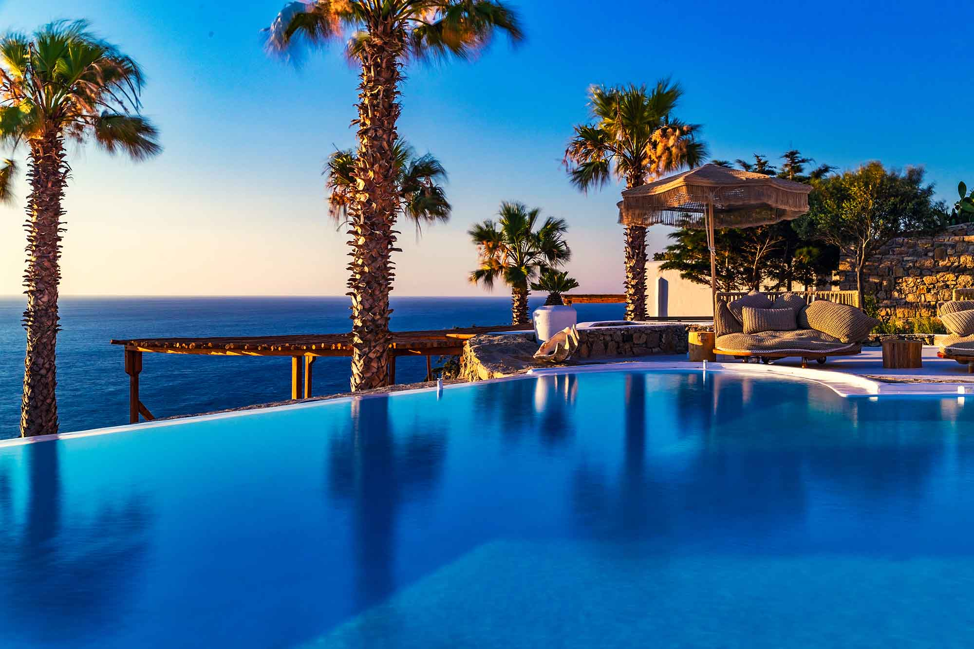 RENT A LUXURIOUS VILLA BY THE SEA IN MYKONOS - VILLA KARKOS - swimming pool with sea view