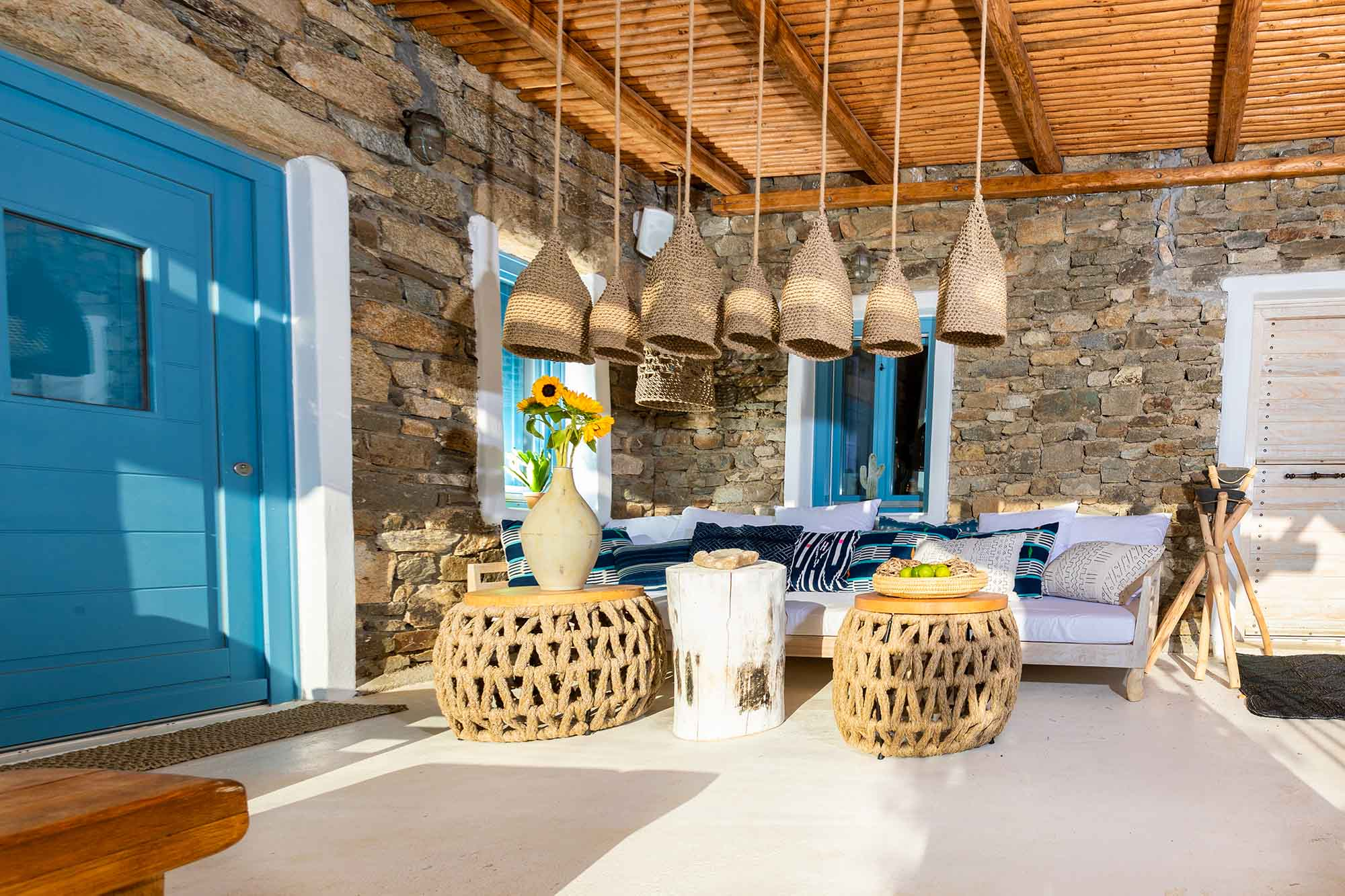 RENT A LUXURIOUS VILLA BY THE SEA IN MYKONOS - VILLA KARKOS - sofa outside
