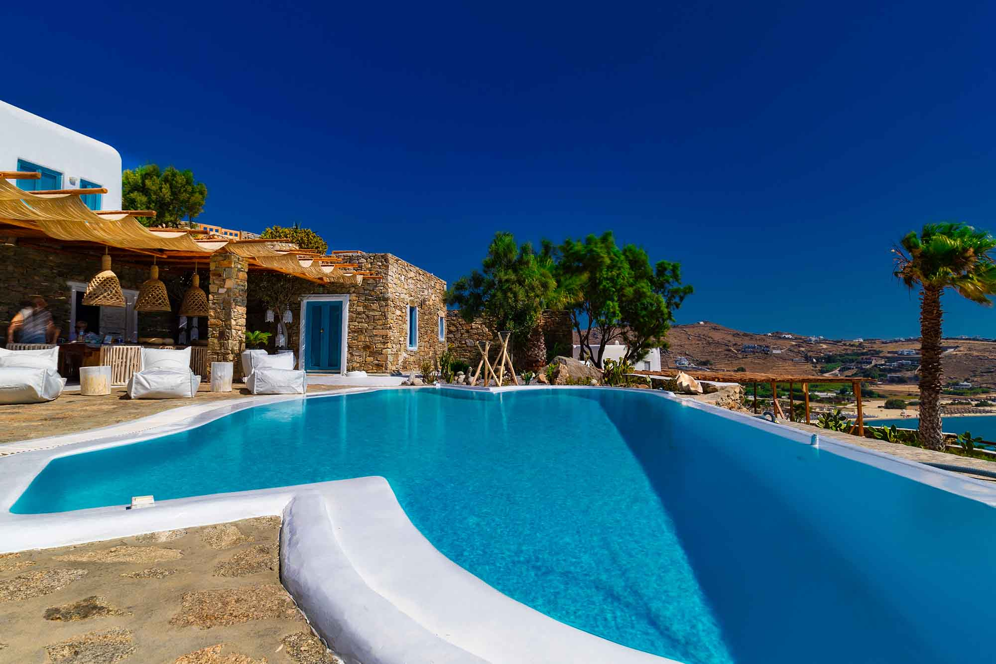 RENT A LUXURIOUS VILLA BY THE SEA IN MYKONOS - VILLA KARKOS - large blue pool